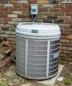 BEFORE: An old outdoor air conditioning unit that needs to be replaced